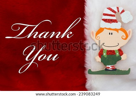 Thank You, A plush red stocking with a Christmas Elf and words Thank You - stock photo
