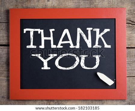 Thank you blackboard sign. Thank you written with chalk on black chalkboard with frame. - stock photo