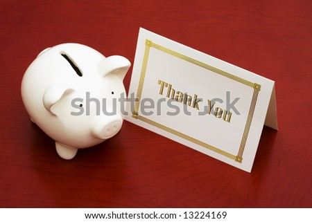 Thank you card and a piggy bank - stock photo