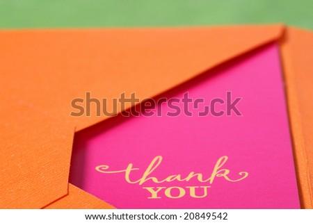 Thank you card in an orange envelope - stock photo