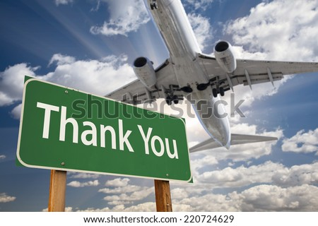 Thank You Green Road Sign and Airplane Above with Dramatic Blue Sky and Clouds. - stock photo