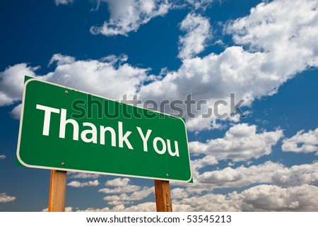 Thank You Green Road Sign with Copy Room Over The Dramatic Clouds and Sky. - stock photo