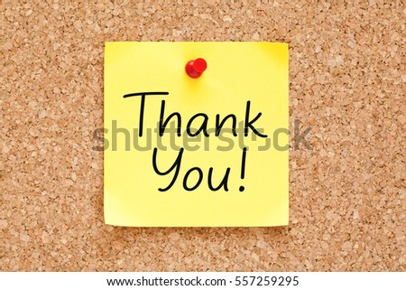 Thank You handwritten on yellow sticky note pinned on bulletin cork board.