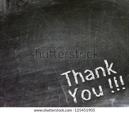 Thank You handwritten with white chalk on a blackboard. - stock photo
