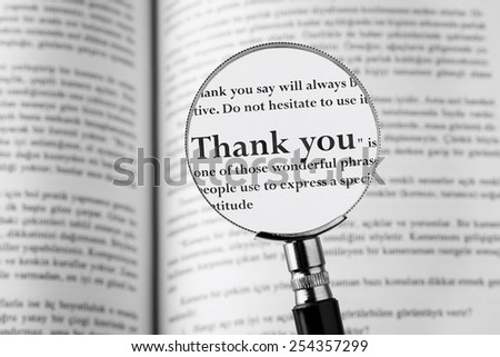 Thank You, holding Magnifying Glass . Studio Shot - stock photo