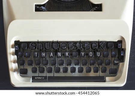 Thank You message written on vintage typewriter keys. Retro filtered image with selective focus