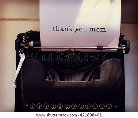 Thank you mom message on a white background against womans hand typing on typewriter - stock photo