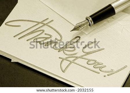 Thank you note and pen - sepia - stock photo