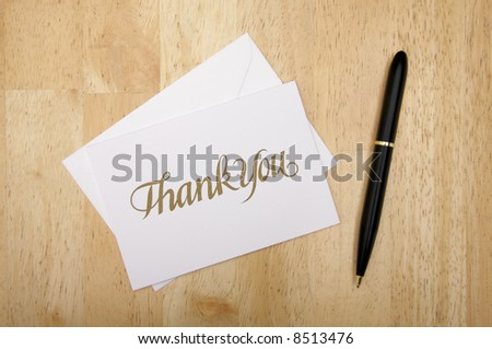 Thank You Note Card and Pen on Wood Background - stock photo