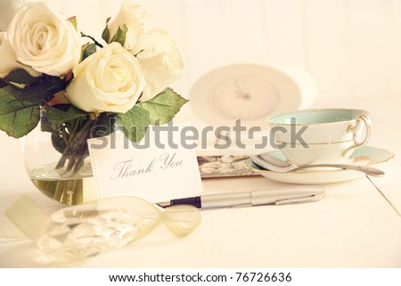 Thank you note on table with nostalgic romantic feel - stock photo