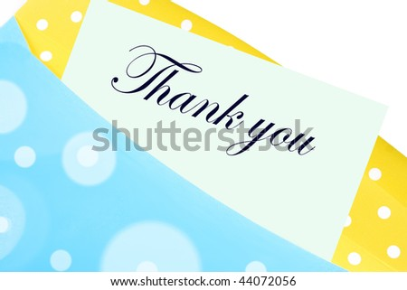 Thank you note or letter in yellow and blue polkadot envelope - stock photo