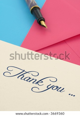 thank you note with two envelopes and a pen - stock photo