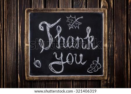 Thank you on chalkboard - stock photo