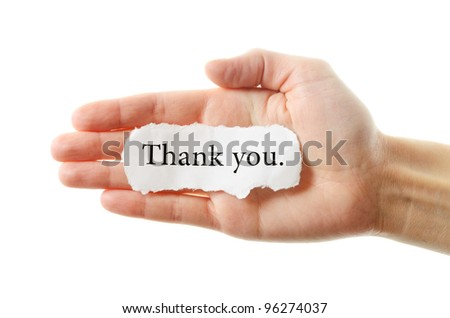 Thank you or thanks concept with hand word and paper. Isolated on white background.
