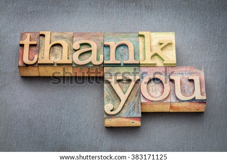 thank you phrase in vintage letterpress wood type blocks stained by color inks - stock photo