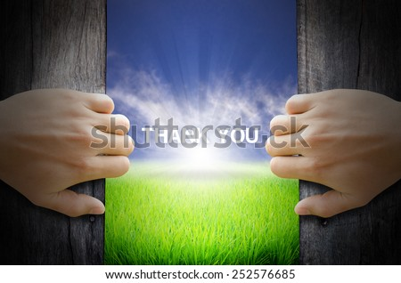 Thank you word. Hand opening an old wooden door and found a texts floating over green field and bright blue Sky Sunrise. - stock photo
