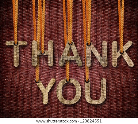 Thank you word hanging by rope as puppeteer on sackcloth background. - stock photo