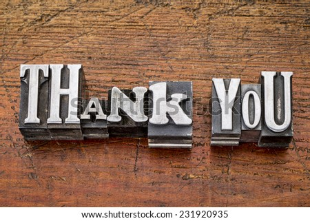 thank you - words in vintage metal type printing blocks over grunge wood, mixed fonts in style and size - stock photo