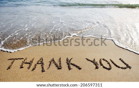 thank you words written on the sand of the beach - stock photo