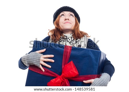 Thankful winter woman holding big present and looking up, isolated on white background. - stock photo
