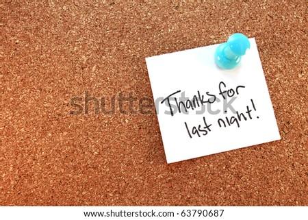 Thanks For Last Night A thanks for last night note tacked on corkboard. Horizontal. - stock photo