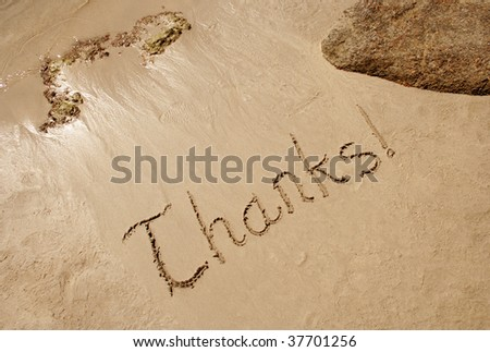 Thanks! handwritten in sand on a beach