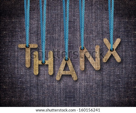 Thanks Letters hanging strings with blue sackcloth background. - stock photo