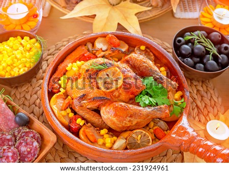 Thanksgiving day dinner, traditional festive food, tasty oven baked turkey with vegetables and lemon, beautiful decorated holiday table - stock photo