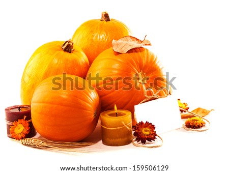 Thanksgiving day greeting card, traditional pumpkin decoration with candles isolated on white background, copy space, autumn concept  - stock photo