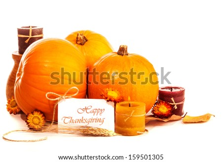 Thanksgiving day still life on isolated on white background, happy holiday, ripe orange gourds with candle and dry flowers, greeting card, harvest season concept - stock photo