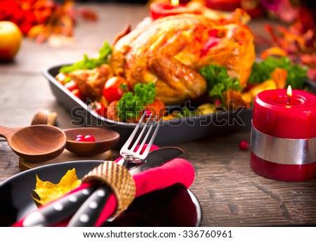 Thanksgiving Dinner. Thanksgiving table served with turkey, decorated with bright autumn leaves. Roasted turkey, table setting  - stock photo