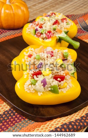 Thanksgiving dish of two yellow peppers stuffed with quinoa salad - stock photo