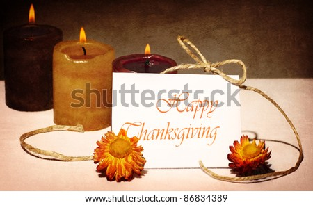 Thanksgiving holiday greeting card, still life decoration with candles over dark grunge background - stock photo