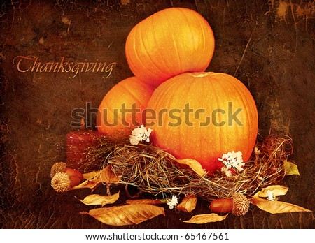 Thanksgiving holiday greeting card with orange gourds & candle - stock photo