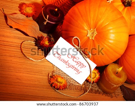 Thanksgiving holiday, pumpkin border still life decoration with candles on the wooden table background, greeting card with text space, harvest concept - stock photo