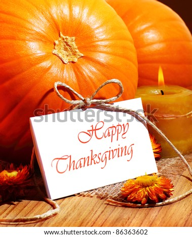 Thanksgiving holiday, pumpkin still life decoration with candle on the wooden table, greeting card with text space, harvest concept - stock photo