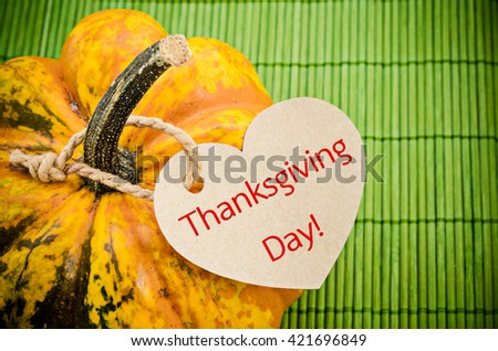 Thanksgiving holiday, pumpkin still life on the wooden mat, greeting card with text space, harvest concept - stock photo