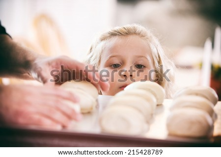 Thanksgiving: Little Girl Hungry For Baked Rolls - stock photo