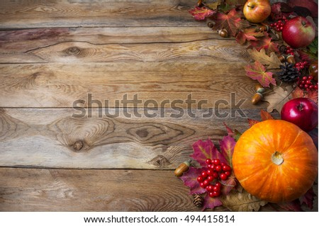 Thanksgiving Or Fall Greeting Background With Pumpkins And Leaves On Rustic Table Copy Space