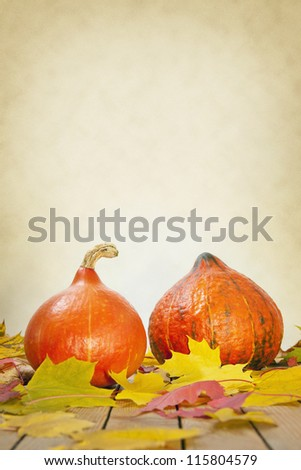 thanksgiving pumpkins background with leaves on a wooden table