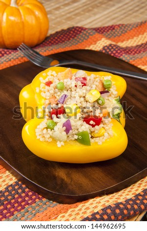 Thanksgiving quinoa salad in a yellow bell pepper - stock photo