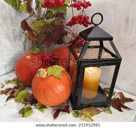 Thanksgiving still life with pumpkins and black lantern on white - stock photo