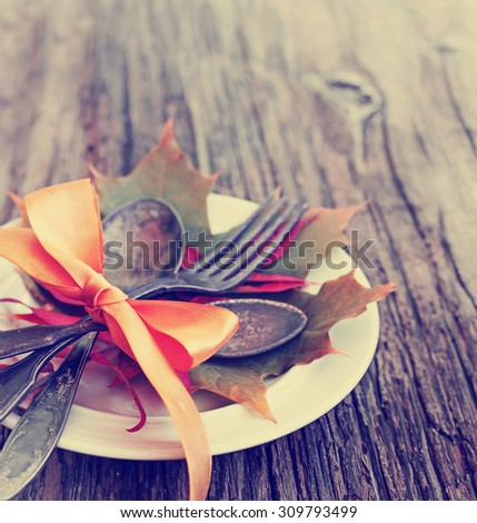 Thanksgiving table setting/ cutlery on the autumn background with autumn leaves,ribbon on wooden background/Thanksgiving holidays background concept - stock photo