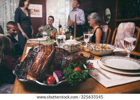 Thanksgiving: Turkey Sits On Platter Ready For Holiday Dinner - stock photo