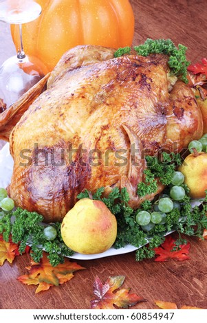 Thanksgiving turkey with fresh pears and grapes. - stock photo
