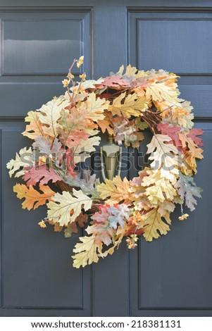 Thanksgiving wreath on black door - stock photo