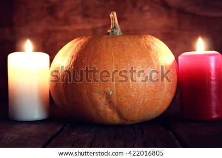thanksgivings day pumpkin and candles