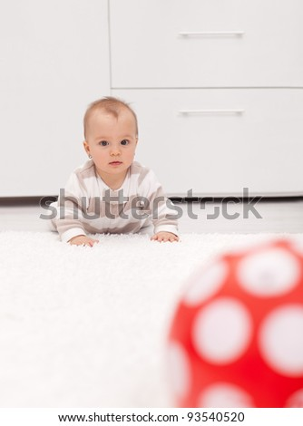 That ball is so far away - little baby girl crawling on the floor