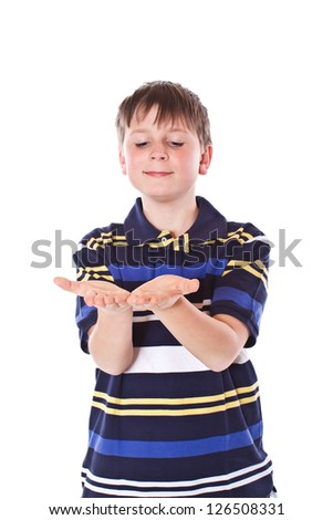 that boy looks in his hands on a white background - stock photo