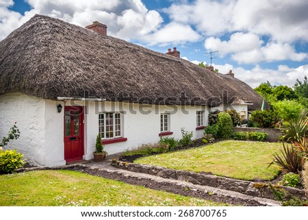 Thatch roof cottage in the picturesque village of Adare, Ireland - stock photo